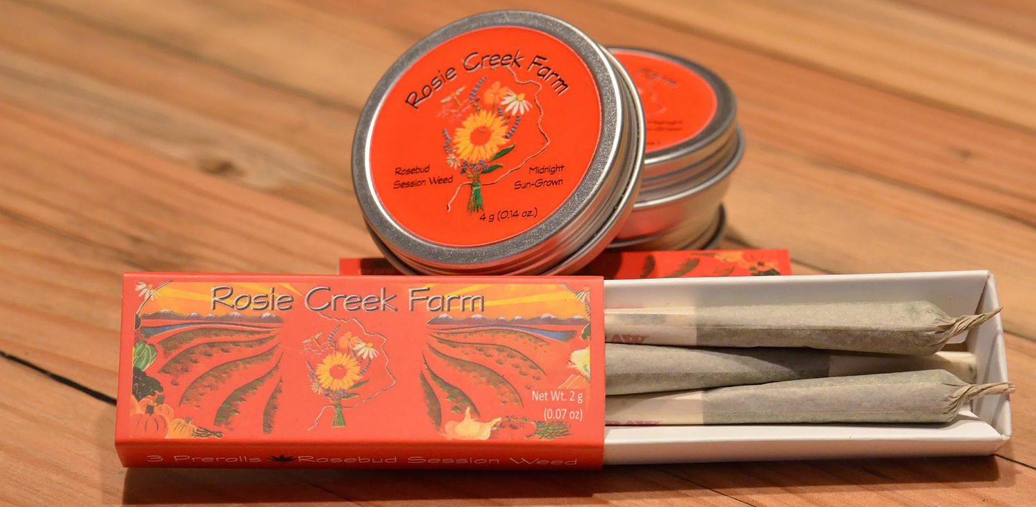 rosie creek farm labeled tins and boxes with marijuana and pre-rolled joints